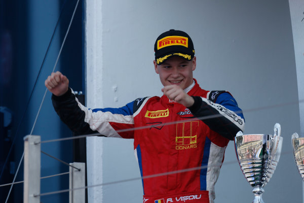 2013 GP3 Series. Round 5.  Hungaroring, Budapest, Hungary. 28th July 2013.  Sunday Race. Robert Visoiu (ROU, MW Arden) celebrates his victory on the podium.  World Copyright: Andrew Ferraro/GP3 Media Service  Ref: _79P2748