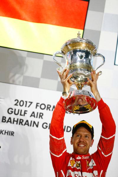 Bahrain International Circuit, Sakhir, Bahrain.  Sunday 16 April 2017. Sebastian Vettel, Ferrari, 1st Position, lifts his trophy. World Copyright: Andrew Hone/LAT Images ref: Digital Image _ONZ0343