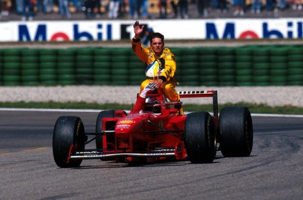 Giancarlo Fisichella (ITA) Jordan is given a lift back to the pits by Michael Schumacher (GER) Ferrari, following his race-ending puncture while fighting for the lead of the race with Gerhard Berger (AUT) Benetton. Formula One World Championship, Rd 10, German Grand Prix, Hockenheim, Germany, 27 July 1997.