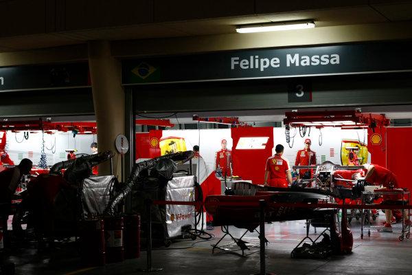Bahrain International Circuit, Sakhir, Bahrain24th April 2009The Ferrari garage at night. Garages. Atmosphere. World Copyright: Charles Coates/LAT Photographicref: Digital Image _26Y0771