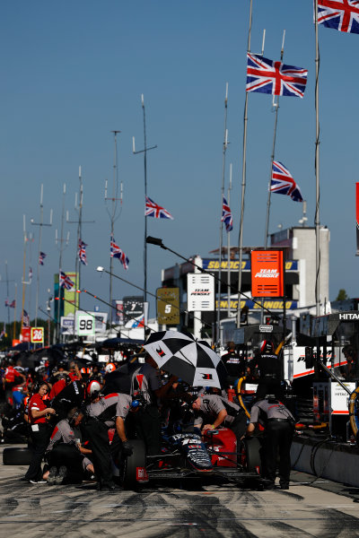 20-21 August, 2016, Long Pond, Pennsylvania USA James Hinchcliffe, Union Jack flags fly in pit lane to honor Justin Wilson ?2016, Michael L. Levitt LAT Photo USA