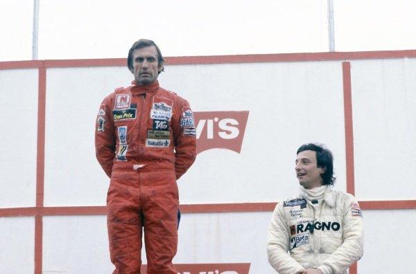 1981 Brazilian Grand Prix.Jacarepagua, Rio de Janeiro, Brazil. 27-29 March 1981.Carlos Reutemann (Williams FW07C-Ford Cosworth), 1st position, and Riccardo Patrese (Arrows A3-Ford Cosworth), 3rd position, on the podium.World Copyright: LAT PhotographicRef: 35mm transparency 81BRA09