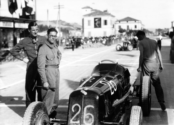 1935 Coppa Acerbo Junior voiturette race Pescara, Italy. 15 August 1935 Dick Seaman, ERA B-type, 1st position, stands with his mechanic Jock Finlayson, before the start, portrait World Copyright: Robert Fellowes/LAT PhotographicRef: 35CA12