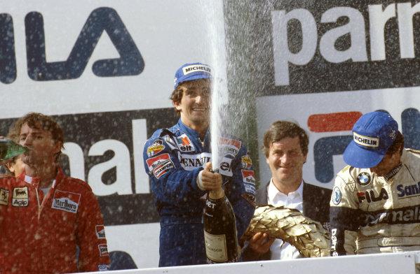 Osterreichring, Austria.12-14 August 1983.Alain Prost (Equipe Renault) 1st position, Rene Arnoux (Ferrari) 2nd position and Nelson Piquet (Brabham BMW) 3rd position on the podium.Ref-83 AUT 09.World Copyright - LAT Photographic