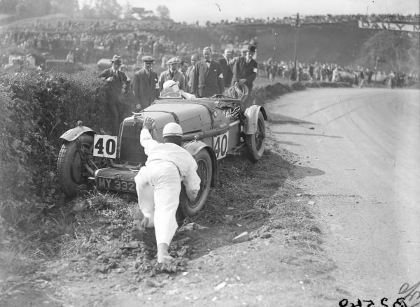 Jack Bezzant attempts to recover his Aston Martin 1.5L after going off just after the start.