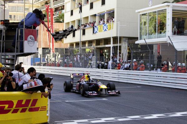 Sebastian Vettel, Red Bull RB7 Renault, crosses the finish line and takes the chequered flag.