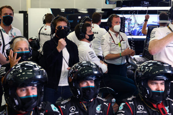 Actor Tom Cruise watches the race from the Mercedes garage