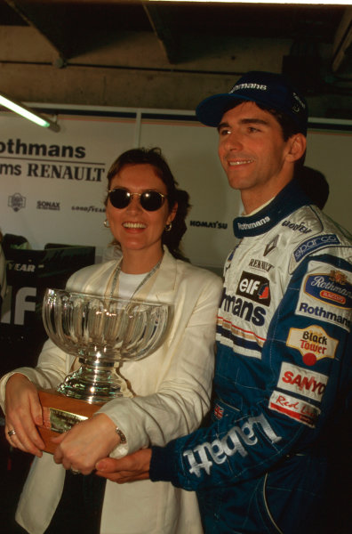 Buenos Aires, Argentina.5-7 April 1996.Damon Hill's wife Georgie firmly holds onto his Grand Prix winning trophy.Ref-96 ARG 06.World Copyright - LAT Photographic