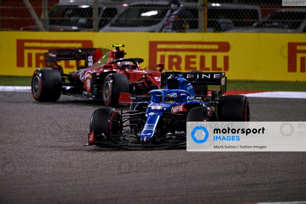 Fernando Alonso, Alpine A521, leads Carlos Sainz, Ferrari SF21