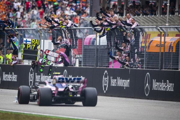 The Racing Point team cheer Lance Stroll, Racing Point RP19, over the line