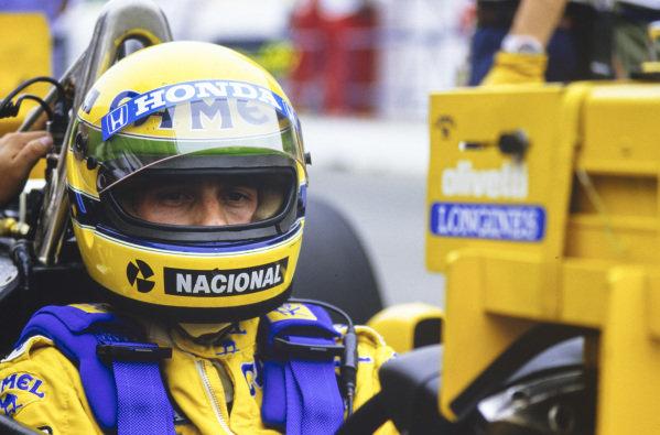 Ayrton Senna watches a timing monitor.