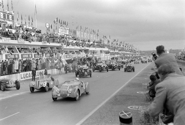 A 1938 Peugeot leads at the start of  the Pre-1939 Retrospective of Le Mans demonstration race.