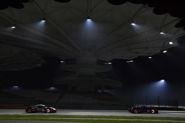 Nobuhiro Imada, Rosso Scuderia, leads Philippe Prette, Blackbird Concessionaires HK