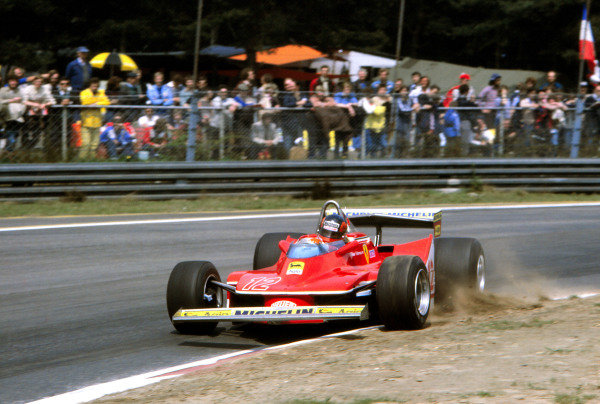 Gilles Villeneuve, Ferrari 312T4, corrects a slide as he puts a wheel on the kerb.
