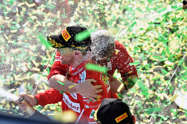 Race winner Sebastian Vettel (GER) Ferrari celebrates on the podium with the champagne at Formula One World Championship, Rd1, Australian Grand Prix, Race, Albert Park, Melbourne, Australia, Sunday 26 March 2017.