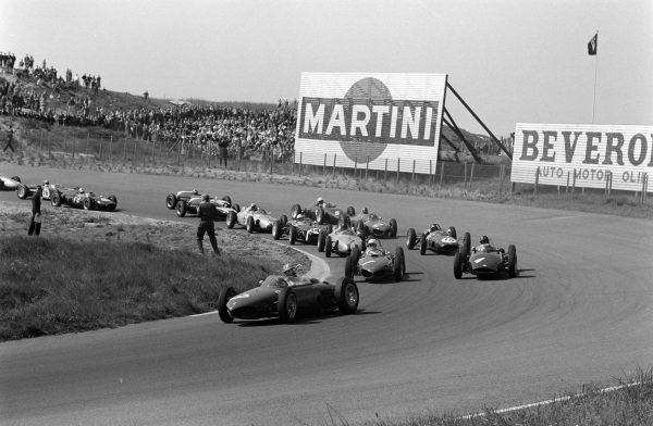 Wolfgang von Trips, Ferrari 156, Phil Hill, Ferrari 156, and Graham Hill, BRM P48/57 Climax, lead the field at the start.
