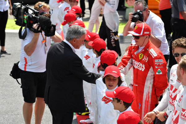 Chase Carey, Chief Executive Officer and Executive Chairman of the Formula One Group and Kimi Raikkonen, Ferrari on the grid