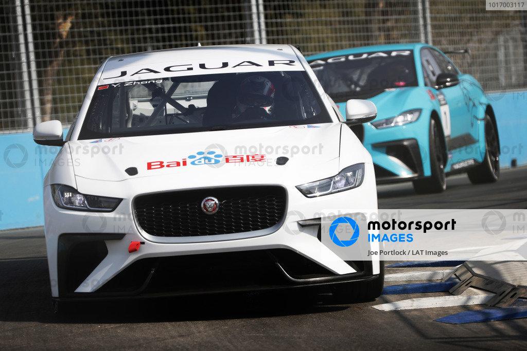 Yaqi Zhang (CHI), Team China leads Alice Powell (GBR), Jaguar VIP car