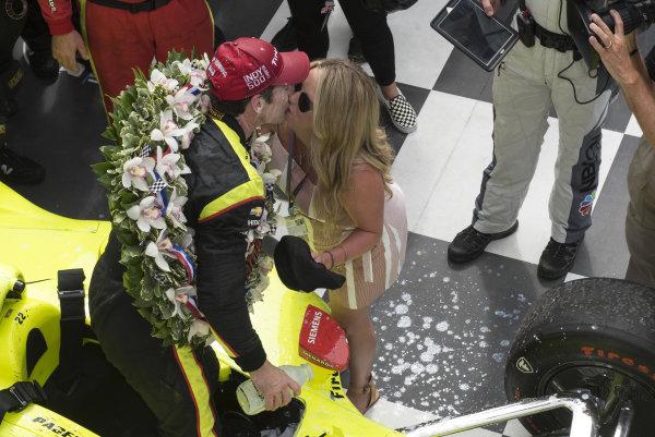 Simon Pagenaud, Team Penske Chevrolet, kisses fiancee Hailey McDermott in victory lane.