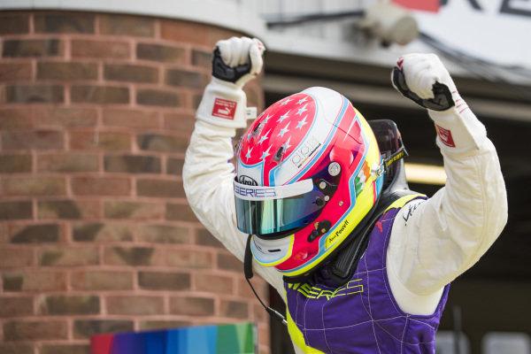 Race winner Alice Powell (GBR) celebrates in Parc Ferme