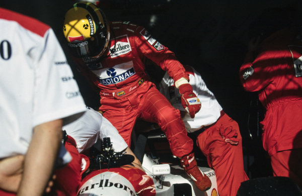 Ayrton Senna gets out of his McLaren MP4-8 Ford.