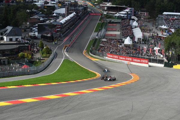 Kimi Raikkonen, Alfa Romeo Racing C38, leads Max Verstappen, Red Bull Racing RB15, and Robert Kubica, Williams FW42