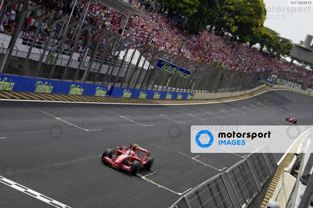 Kimi Räikkönen, Ferrari F2007 raises a fist as he celebrates winning the Brazilian GP.