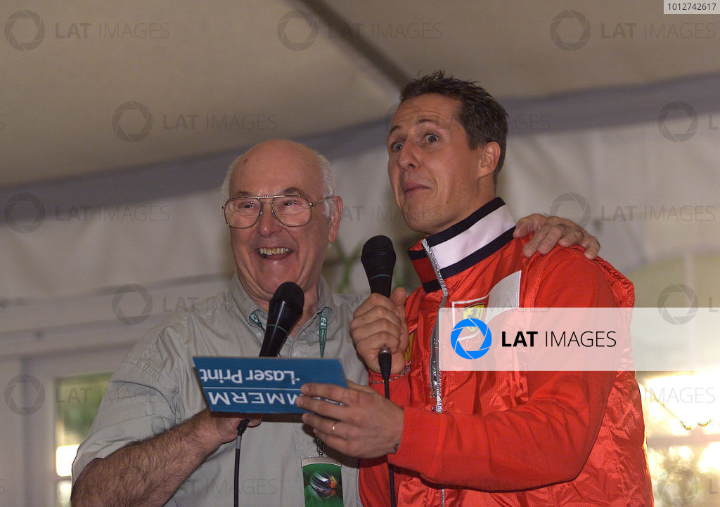 2001 American Grand Prix - QualifyingIndianapolis, United States. 29th September 2001.Michael Schumacher, Ferrari F2001, with retiring comentator Murray Walker, portrait.World Copyright: Steve Etherington/LAT Photographicref: 18mb Digital Image