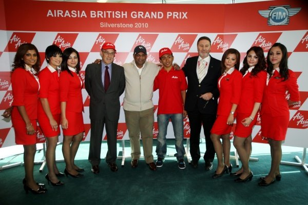 Carmelo Ezpeleta (ESP) CEO Dorna Sports S.L. and Tony Fernandes (MAL), CEO AirAsia Group, 18-year-old Mohd Zulfahmi Khairuddin (MAL) who will become the first Malaysian to compete in MotoGP's 125cc category, and Richard Phillips (GBR), Managing Director Silverstone Circuit.AirAsia Signs As Title Sponsor for 2010 MotoGP British Grand Prix, Silverstone, England, Wednesday 10 February 2010.