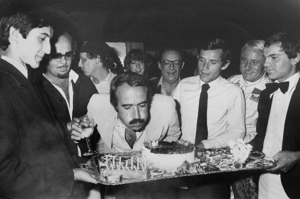 Clay Regazzoni celebrates his birthday with Jacky Ickx and Niki Lauda plus guests, portrait.  World Copyright: LAT Photographic. Ref:  B/W Print.