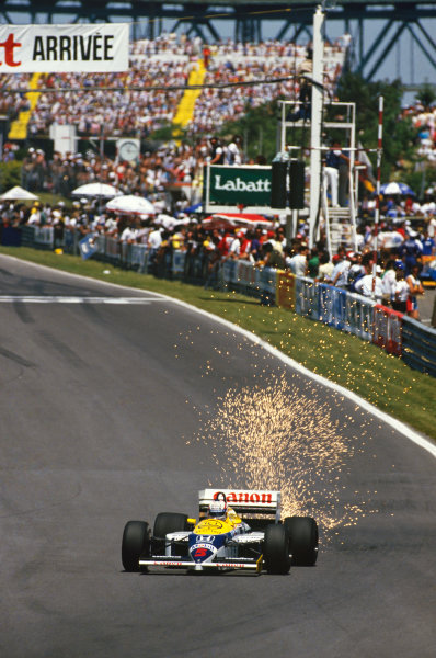 1986 Canadian Grand Prix  Montreal, Quebec, Canada. 13-15th June 1986.  Nigel Mansell, Williams FW11 Honda, 1st position, puts up a shower of sparks.  Ref: 86CAN15. World copyright: LAT Photographic