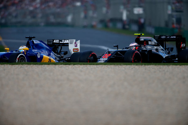 Albert Park, Melbourne, Australia. Sunday 20 March 2016. Marcus Ericsson, Sauber C35 Ferrari, leads Jenson Button, McLaren MP4-31 Honda. World Copyright: Sam Bloxham/LAT Photographic ref: Digital Image _W2Q4235