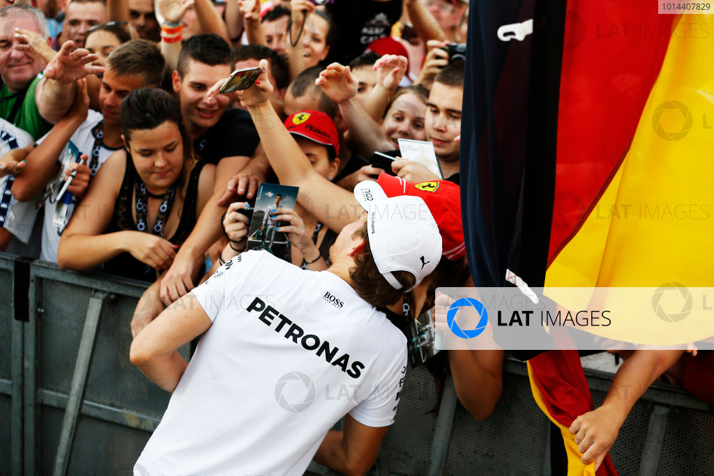Hungaroring, Budapest, Hungary. Thursday 23 July 2015. Nico Rosberg, Mercedes AMG, signs autographs for fans. World Copyright: Charles Coates/LAT Photographic ref: Digital Image _J5R0641