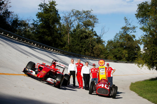 Autodromo Nazionale di Monza, Monza, Italy. Saturday 5 September 2015. Shell announce their renewed partnership with Ferrari on the Monza banking with Sebastian Vettel, Ferrari, John Abbott, Downstream Director, Shell, Mauricio Arrivabene, Team Principal, Ferrari, Istvan Kapitany, Executive Vice President of Retail, Shell and Kimi Raikkonen, Ferrari, alongside a Ferrari SF-15T and a Ferrari 166 F2 car. World Copyright: Glenn Dunbar/LAT Photographic ref: Digital Image _89P7785
