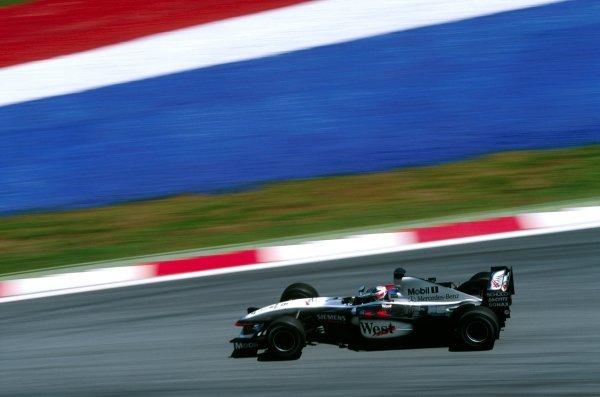 Kimi Raikkonen (FIN) McLaren Mercedes MP4/17D took his maiden F1 victory. Malaysian Grand Prix, Rd2, Sepang, Kuala Lumpur, 23 March 2003. BEST IMAGE