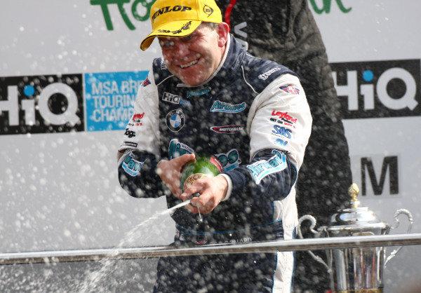 Brands Hatch, UK. 5th April 2009. Rds 1,2,3. Rob Collard, Motorbase BMW, celebrates the team's first BTCC win, on the podium. Portrait.  World Copyright: Kevin Wood/LAT Photographic Ref: Digital Image IMG_9078a
