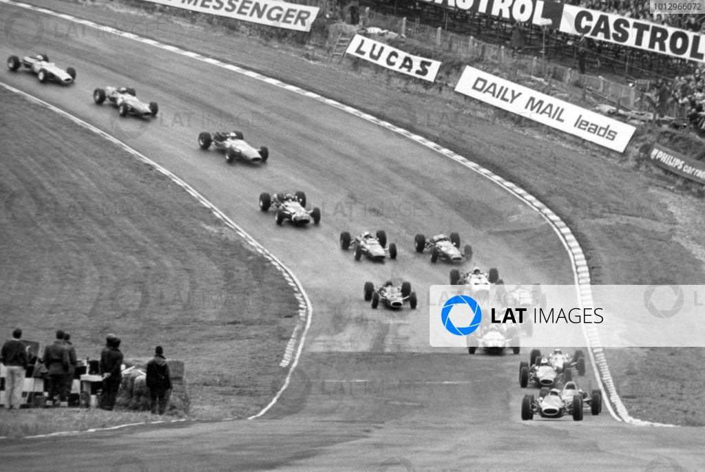 1966 British Grand Prix.Brands Hatch, Great Britain. 16 July 1966.Jack Brabham, Brabham BT19-Repco, 1st position, leads Dan Gurney, Eagle AAR101-Climax, retired, Denny Hulme, Brabham BT20-Repco, 2nd position, Jim Clark, Lotus 33-Climax, 4th position, John Surtees, Cooper T81-Maserati, retired, Jochen Rindt, Cooper T81-Maserati, 5th position, Jackie Stewart, BRM P261, retired, Graham Hill, BRM P261, 3rd position, Bruce McLaren, McLaren M2B-Serenissima, 6th position, Chris Irwin, Brabham BT11-Climax, 7th position, Mike Spence, Lotus 33-BRM, retired, Jo Siffert, Cooper T81-Maserati, not classified, Guy Ligier, Cooper T81-Maserati, 10th position, Jo Bonnier, Brabham BT7-Climax, retired, and John Taylor, Brabham BT11-BRM, 8th position, at the start, action.World Copyright: LAT PhotographicRef: Autosport b&w print