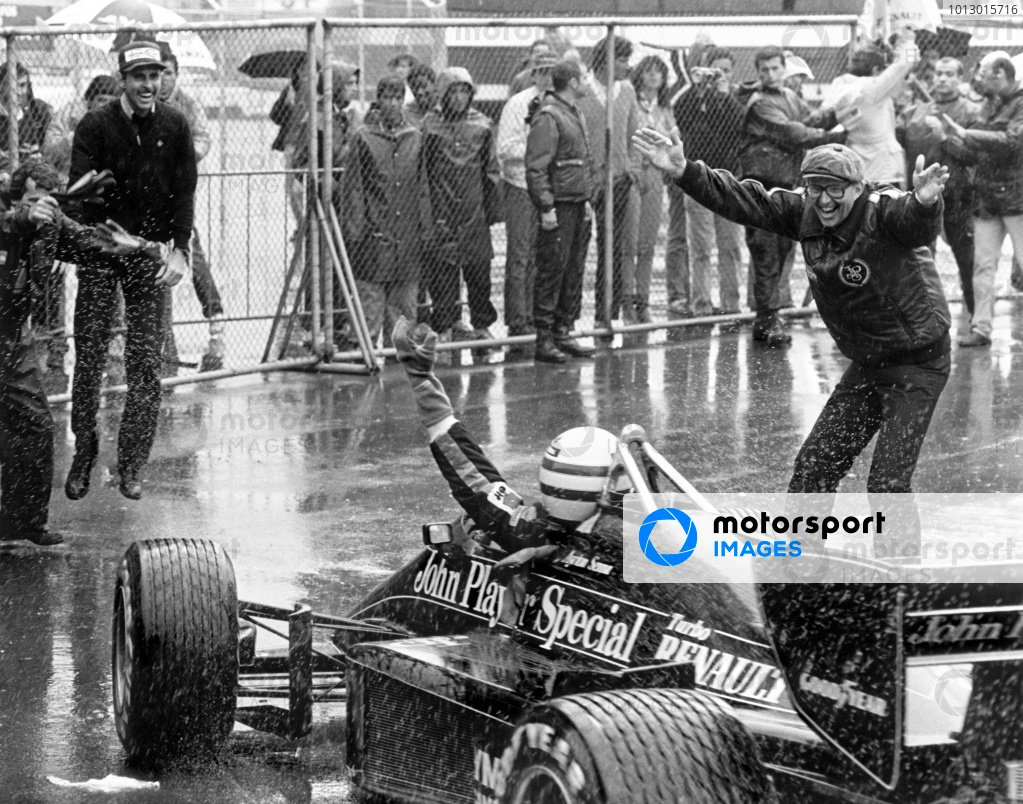 1985 Portuguese Grand Prix.Estoril, Portugal. 19-21 April 1985.Ayrton Senna (Lotus 97T-Renault) celebrates 1st position with Team Manager Peter Warr (right) in parc ferme.World Copyright: LAT PhotographicRef: BATPOR7