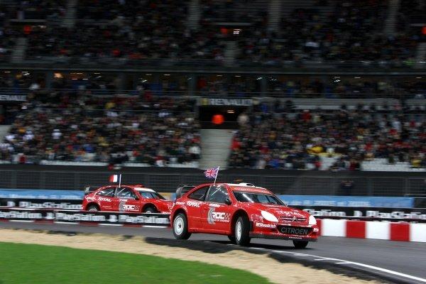 Colin McRae (GBR) vs Sebastien Loeb (FRA) in the rally final. Race of Champions, Stade de France, Paris, France, 16 December 2006. DIGITAL IMAGE