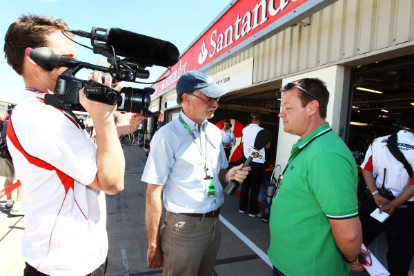 Mark Hughes (GBR) JPSK Sports Vice President, a Jaypee Group subsidiary is interviewed by Star Sports. Formula One World Championship, Rd 10, British Grand Prix, Practice Day, Silverstone, England, Friday 9 July 2010.