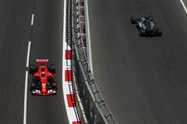 Baku City Circuit, Baku, Azerbaijan. Friday 23 June 2017. Kimi Raikkonen, Ferrari SF70H, and Lewis Hamilton, Mercedes F1 W08 EQ Power+, on opposite sections of the circuit. World Copyright: Charles Coates/LAT Images ref: Digital Image AX0W4797