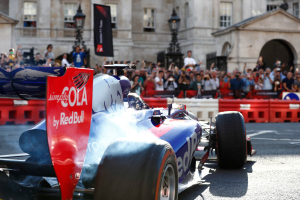 London, United Kingdom.  Wednesday 12 July 2017. A Toro Rosso STR12 Renault drives past Horse Guards? Parade. World Copyright: Glenn Dunbar/LAT Images  ref: Digital Image _X4I1049