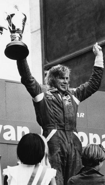 Zandvoort, Holland. 27th - 29th August 1976. James Hunt (McLaren M23 Ford) 1st position, on the podium, portrait.  World Copyright: LAT Photographic. Ref: B/W Print.