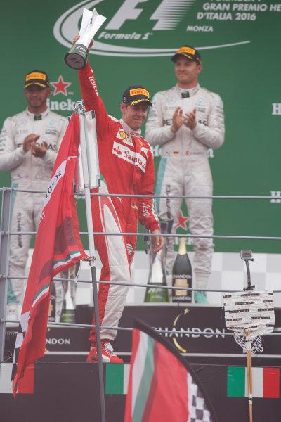 Autodromo Nazionale di Monza, Italy. Sunday 04 September 2016. Sebastian Vettel, Ferrari, 3rd Position, with his trophy on the podium. World Copyright: Sam Bloxham/LAT Photographic ref: Digital Image _SLA8694
