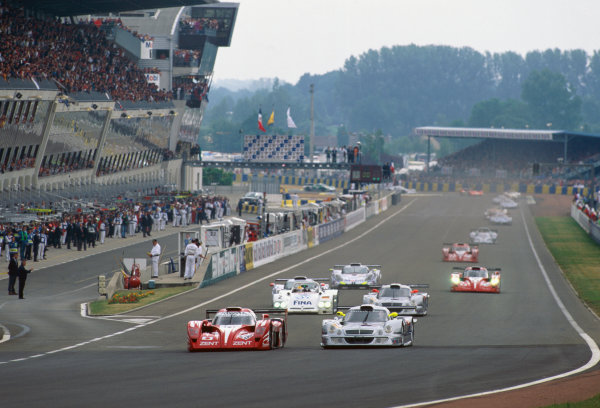 1998 Le Mans 24 Hours. Le Mans, France. 6th - 7th June 1998. Martin Brundle/Emmanuel Collard/Eric Helary (Toyota GT-One), retired, leads  Bernd Schneider/Klaus Ludwig/Mark Webber (Mercedes-Benz CLK LM), retired, at the start of the race, action.  World Copyright: LAT Photographic. Ref:  98LM20