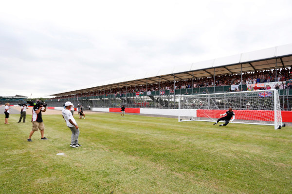 Silverstone, Northamptonshire, England. Thursday 3 July 2014. Lewis Hamilton, Mercedes AMG, takes some penalty kicks as part of a feature for Sky Sports F1. World Copyright: Andrew Ferraro/LAT Photographic. ref: Digital Image _FER9753