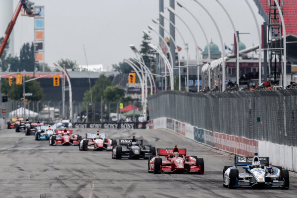 20 July, 2014, Toronto, Ontario, Canada Helio Castroneves leads a line of cars into turn 1 ©2014, Michael L. Levitt LAT Photo USA