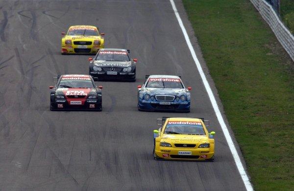 Manuel Reuter, (GER) Team Phoenix Opel Astra Coupe, leading over Timo Scheider (GER) Team Holzer Opel Astra Coupe, Peter Dumbreck (GBR) Original-Teile AMG-Mercedes CLK, Uwe Alzen (GER) Warsteiner AMG-Mercedes CLK and Laurent Aiello (FRA) Team Abt-Sportsline Audi TT.DTM Championship, Rd9, Zandvoort, Holland. 29 September 2002.DIGITAL IMAGE