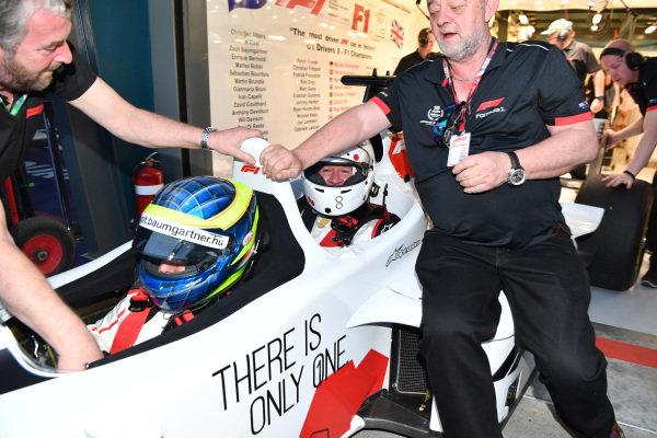 Zsolt Baumgartner (HUN) F1 Experiences 2-Seater driver, F1 Experiences 2-Seater passenger and Paul Stoddart (AUS) at Formula One World Championship, Rd1, Australian Grand Prix, Qualifying, Melbourne, Australia, Saturday 24 March 2018.