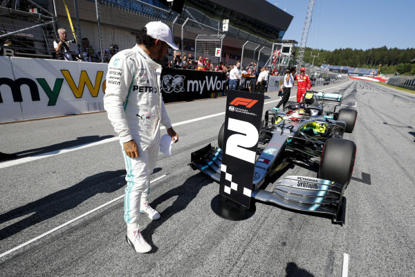 Lewis Hamilton, Mercedes AMG F1 looks at the second place board in Parc Ferme